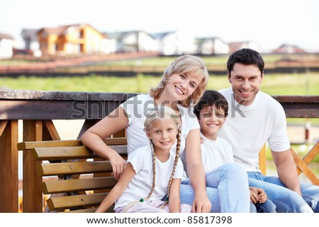 Happy family homes on the background