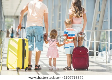 Happy family in airport departures. People in terminal preparing for the vacation Photo stock ©