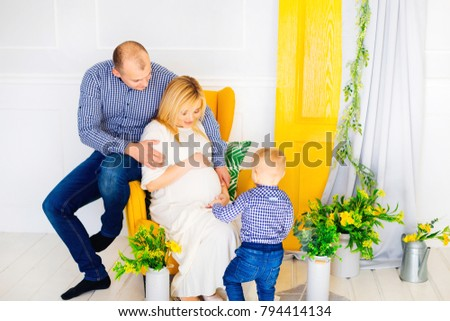happy family in anticipation of the replenishment photographed on a background of decoration #794414134