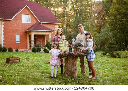 happy family in backyard of new home
