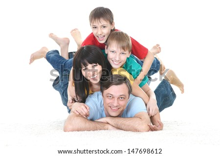 happy family in colored T-shirts on white background