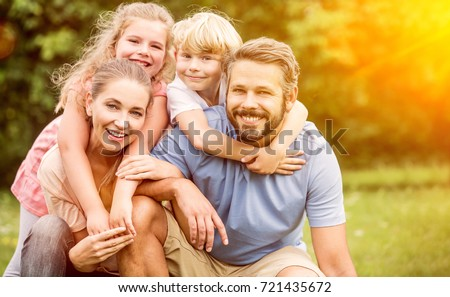 Happy family in harmony with two children playing and laughing