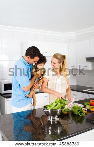happy family in home kitchen cooking food - stock photo
