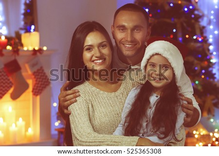 Happy family in living room decorated for Christmas #525365308