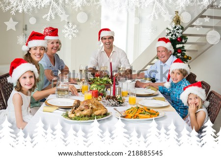 Happy family in Santa hats having Christmas meal against fir tree forest and snowflakes
