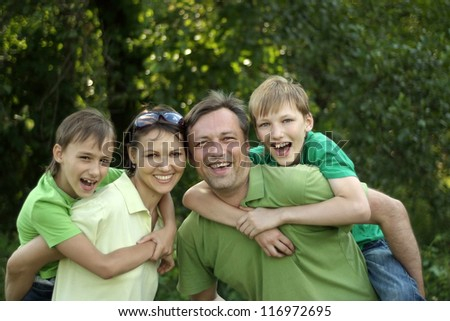 happy family in the green in a summer park
