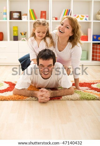 Happy family in the kids room laying on the floor