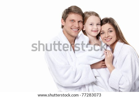 Happy family in the robes on a white background