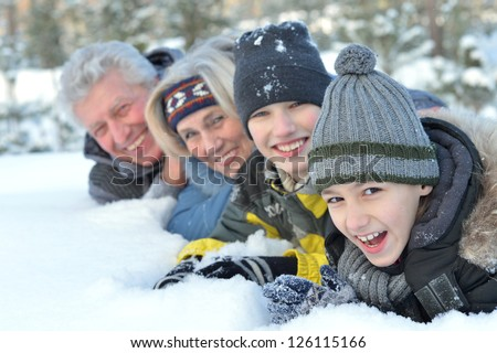 Happy family in warm clothing in winter outdoors