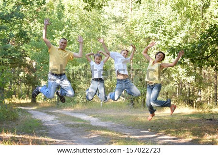 Happy family jumping in park