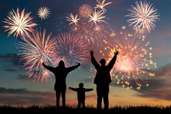 Happy family look at holiday fireworks in sky, celebration card