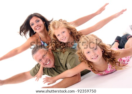 Happy family lying down on the floor and having fun