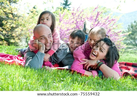 Happy family lying on a blanket