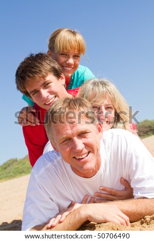 happy family lying on beach