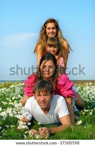 Happy family lying on grass