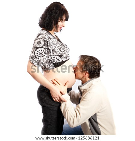 happy family, man kissing woman's pregnant belly  a white background