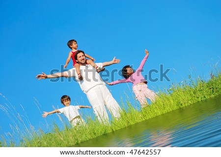 Happy family, meadow, river