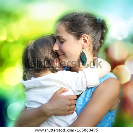 Happy family moments - Mother and child have a fun.