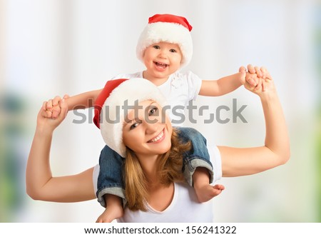 happy family mother and baby in red Christmas hats