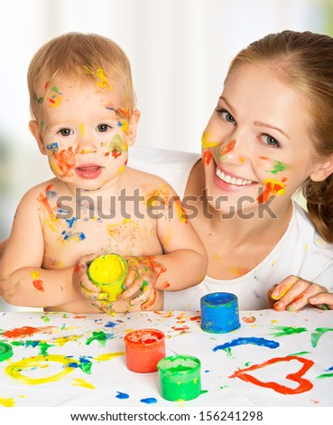 happy family mother and baby paint colors hands dirty