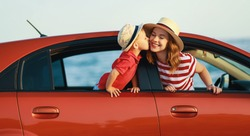 happy  family mother and child boy goes to summer travel trip in the car