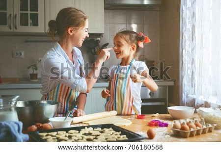 Happy family mother and child daughter bake kneading dough in the kitchen #706180588