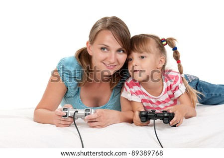 Happy family - mother and child playing a video game