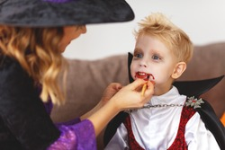happy family mother and son getting ready for halloween make make-up