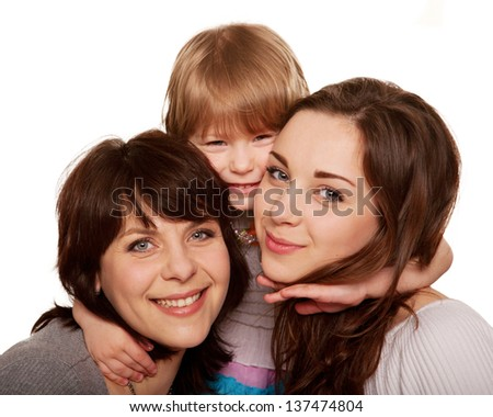 Happy family, mother and two daughters, a teenager and a toddler. Isolated on white background