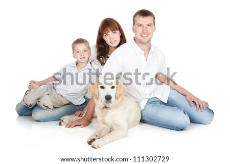 Happy family - mother, father and little son with a big dog sitting over white background