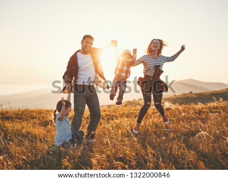 Happy family: mother, father, children son and  daughter on nature  on sunset #1322000846