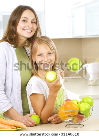 Happy Family Mother with her Daughter eating Healthy food. Diet. Healthy Eating Concept