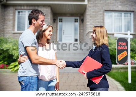 Happy Family near new home. Residential construction background.