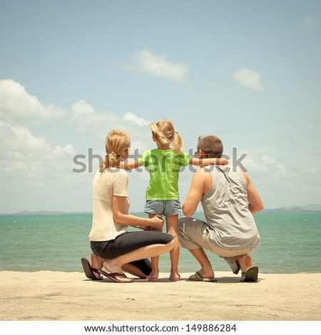 Happy family near the beach in the day time