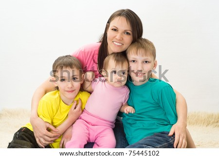 happy family of five on white