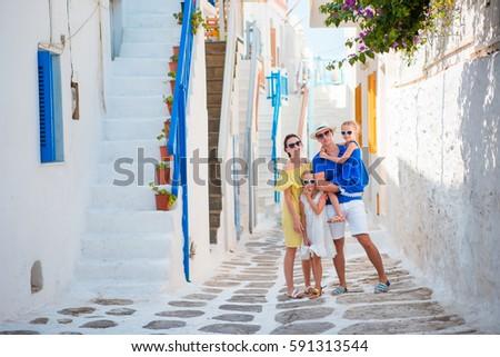 Happy family of four in greek village