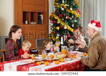 Happy family of three generations over celebratory table at home interior #199707443