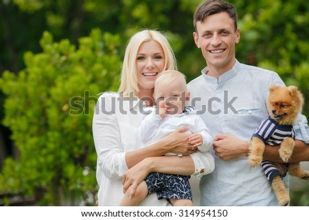 happy family of three having fun and smiling outdoor. Happy young family spending time together outside. Happy mother, father and son #314954150