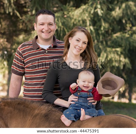 Happy Family of Three Laughing
