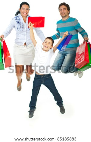 Happy family of three members jumping and holding shopping bags isolated on white background