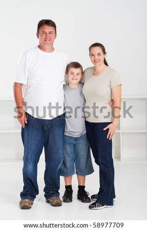 happy family of three standing together