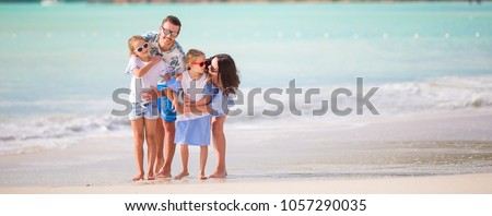 Happy family on a beach during summer vacation #1057290035