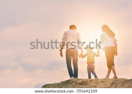 Happy family On a family holiday, have fun together. This will be the smile of parents #705642109