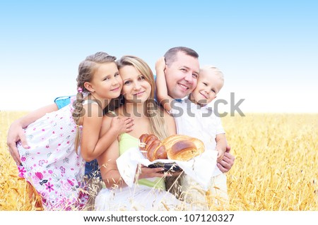 happy family on a field of wheat and bread