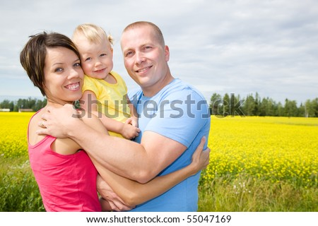 Happy family on countryside