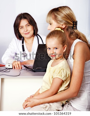 Happy family on reception at doctor.