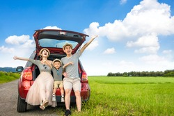 Happy family on  road trip in the car. having fun with summer vacation