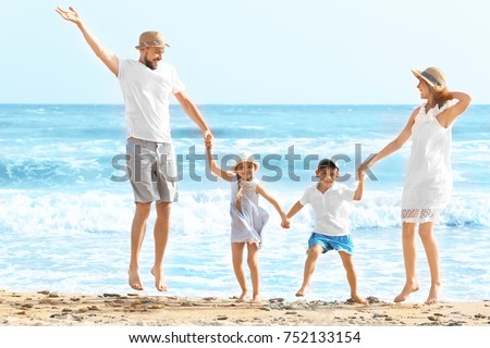 Happy family on sea beach at resort #752133154