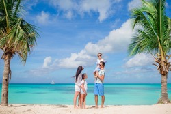 Happy family on the beach at summer vacation