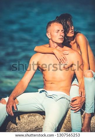 happy family on the beach stone suntanning #1307565253